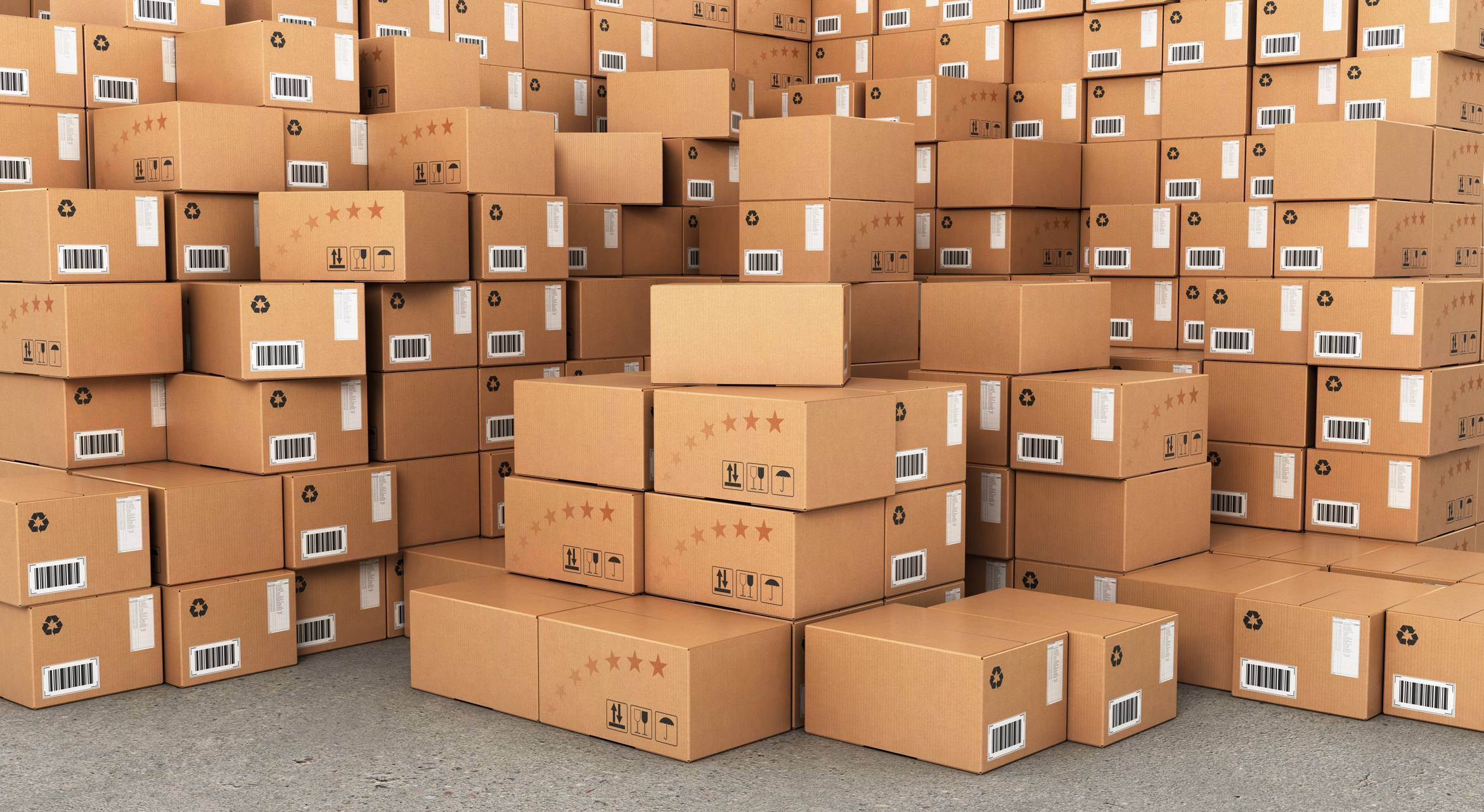 Large stacks of cardboard boxes featuring ink and labels.
