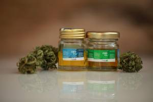 hemp buds and CBD bottles with labels