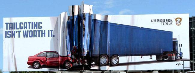 Billboard of a car wrecking into a semi truck