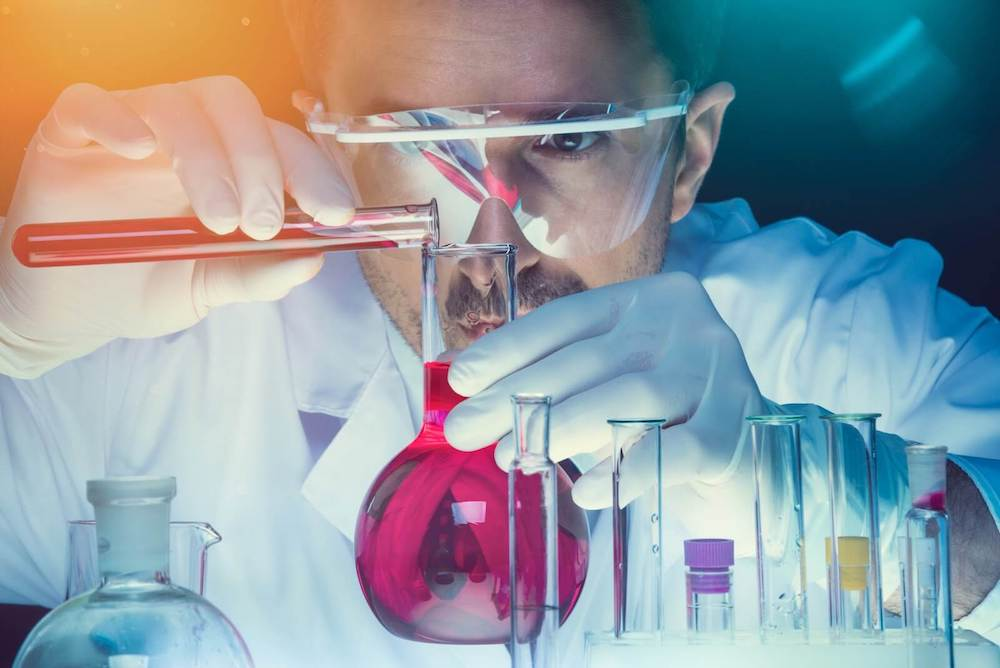 Chemist in lab formulating ink.